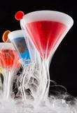 Cocktails with ice vapor on bar desk Stock Image
