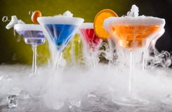 Cocktails with ice vapor on bar desk Stock Photography
