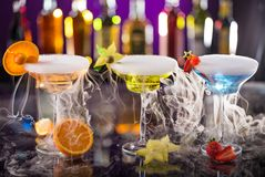 Cocktails with ice vapor on bar desk Royalty Free Stock Photo