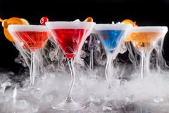 Cocktails with ice vapor on bar desk Stock Photo