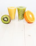 Cocktails from kiwi and orange Stock Images