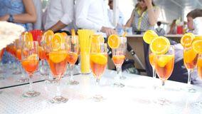 Cocktails with lemon and orange in glasses. Cocktail party at a. Wedding party stock footage