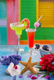 Cocktails margarita sex on the beach in tropical house. Cocktails margarita sex on the beach in colorful tropical house with starfish and sunglasses Royalty Free Stock Image