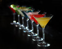 Cocktails in martini glasses. Stand among Royalty Free Stock Photo