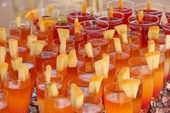 Cocktails with melon pieces at tropical resort. Holiday concept. Bright cocktails with melon pieces at tropical resort. Holiday concept. Drink in vacations stock photography