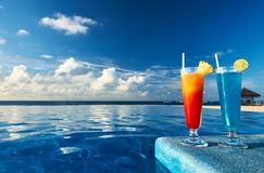 Cocktails near swimming pool. Cocktails near the swimming pool Stock Photography