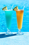 Cocktails near swimming pool Stock Photos