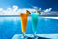 Cocktails near swimming pool stock image