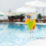 Cocktails near the swimming pool Stock Photos