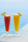 Cocktails near swimming pool stock photography