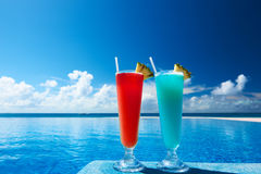Cocktails near swimming pool stock images