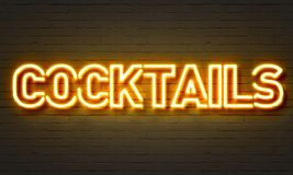 Cocktails neon sign. On brick wall background Stock Images