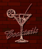 Cocktails neon sign. Over a brick wall Stock Photography