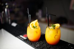 Cocktails with orange at the bar. Cocktails with orange at the bar Royalty Free Stock Photos