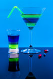 Cocktails and pills in a bar, blue background Stock Photography