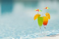 Cocktails by he pool. Close up view at cocktails by he pool Royalty Free Stock Photo