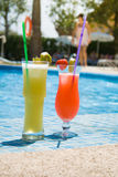 Cocktails at the pool. Vacation at the pool with Cocktails - just relax and look into the sun Stock Image