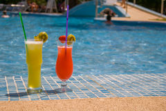 Cocktails at the pool. Vacation at the pool with Cocktails - just relax and look into the sun Stock Photography