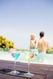 Cocktails on pools edge Stock Image