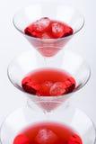 Cocktails rouges dans une ligne Photographie stock