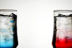 Cocktails rouges et bleus Photographie stock libre de droits