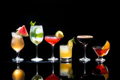 Cocktails. Selection of colorful festive Christmas drinks, alcoholic beverages and cocktails in elegant glasses on a dark background with copy space stock photos