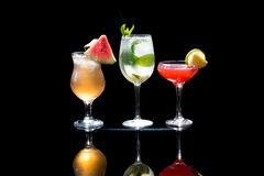 Cocktails. Selection of colorful festive Christmas drinks, alcoholic beverages and cocktails in elegant glasses on a dark background with copy space royalty free stock images