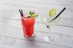 Cocktails set. Margarita, red alcohol cocktail on wooden background close up. Stock Photos