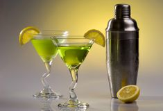 Cocktails and Shaker. This image shows a pair of drinks along with a cocktail shaker royalty free stock photos