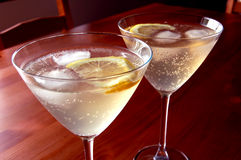 Cocktails with slice of lemon. Two cocktails in martini glasses with slice of lemon Stock Images