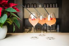 Cocktails on spot in beauty salon. Welcome drinks. Holiday party. Beautiful women`s welcome drinks with raspberries and black tubules in luxury beauty salon stock images