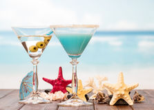 Cocktails, starfish and sinks on sea background. Stock Photo