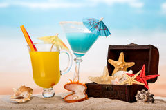 Cocktails and starfishes on beach Stock Photos