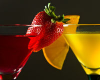 Cocktails with strawberry and orange Stock Images