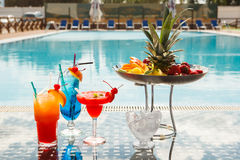Cocktails. Sun lounges and cocktails by the pool Royalty Free Stock Image
