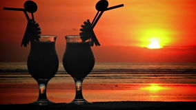 Cocktails at sunset 2. Two glasses with cocktails at sunset in the sea 2 stock footage