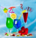 cocktails with tropical fruit and flowers Royalty Free Stock Photos