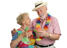 Cocktails on Vacation. An attractive elderly couple enjoying cocktails on a tropical vacation Stock Photography
