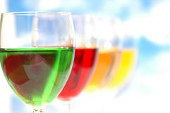 Cocktails of various colors. Against the blue sky Royalty Free Stock Images