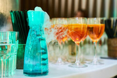 Cocktails and wine glasses. Glasses of spritz aperitif aperol red cocktail with orange slices and ice cubes on wood table Royalty Free Stock Photography