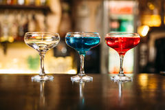 Cocktails on wooden bar counter closeup Royalty Free Stock Image