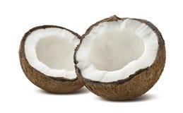Coco áspero meias partes quebradas isoladas no fundo branco Imagem de Stock