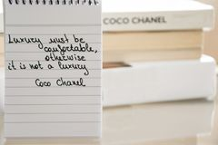 Coco Chanel quotes written on a block note, inspiration phrase. `Luxury must be comfortable, otherwise it is not a luxury royalty free stock images