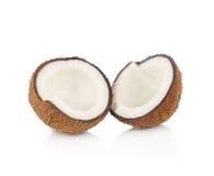 Coco cortado por la mitad en el fondo blanco fotografía de archivo