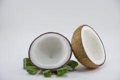 Coco no fundo branco para o cozimento ou a matéria prima Imagem de Stock