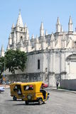 Coco Taxi. Famous Cuban Coco Taxi in front of a church in Havana Cuba Royalty Free Stock Photo