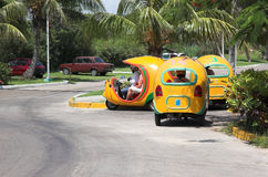 Coco taxi, Varadero. Yellow coco taxis in Varadero, Cuba waiting for passenges Royalty Free Stock Photography