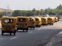 Coco Taxis In Havana Cuba. Coco taxis driving on street in Havana Cuba Royalty Free Stock Photos