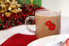 Cocoa. Hot cocoa or chocolate milk in festive Christmas glass mug Stock Images