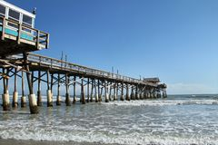 Cocoa Beach Pier, Florida and Pelican stock images